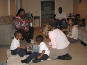 Two Toddlers on Floor with Therapist