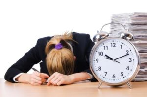 Stressed Woman Passed Out Desk