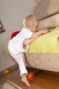 Toddler Climbing Onto Couch