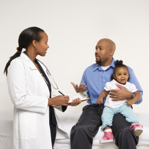 Father and Toddler with a Doctor