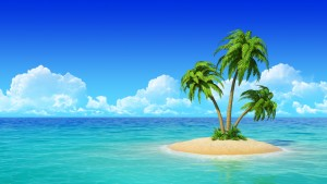 Tiny island with palm trees in the middle of the ocean